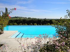 Park with pool and tennis court at Villa di Rovero photo n.2