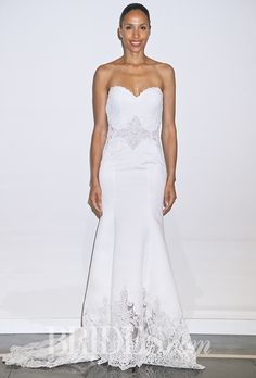 Brides: Fall 2015 Wedding Dress Trends || and now, the latest and greatest, designed to give you that oh-so-hot Fall 2015 look: sagging, smashed tits. Or maybe those ovals are doilies that coordinate with the tablecloth used for the lower skirt and train?