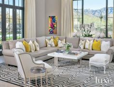 Dove gray linen covers a sectional in this mediterranean #livingroom, while a fused-hide #rug adds a touch of glamour | See MORE at www.luxesource.com | #luxemag | #interiordesign #design #interiors #decor