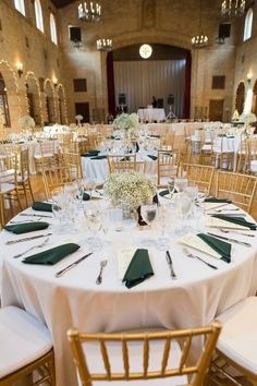 white babies breath centerpiece, green napkin wedding, gold chivari chairs from green glam St Francis Hall DC wedding