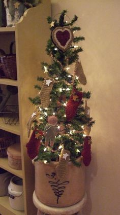 Stocking Tree!  love the .little wool stockings.  Great for small wool scraps