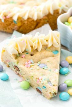 Easter Sugar Cookie Cake - this easy sugar cookie recipe is filled with spring M&Ms and sprinkles and baked in a cake pan.