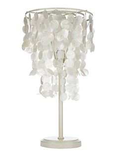 At $99, the lower-cost lamp features dangling capiz shells for a beach-chic version. The stylish table lamp can be found at pbteen.com.