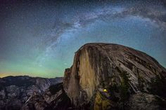 Picture of a tent aglow on the side of Half Dome in Yosemite