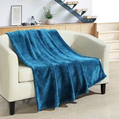 Add a soft and comfortable feel any time of year with this elegant plush micro mink waffle textured throw blanket. It is available in an array of rich bold colors, sure to accent your home for years to come.