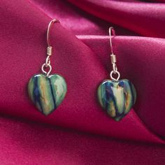 Marchbrae Heathergems Jewellery Collection A pair of classic sterling silver heart drop earrings. Each piece is unique and handmade in Scotland from Scottish pressed heather. Every pair of earrings is supplied in a gift box with a story card describing how it was created. Please note that each Heathergem item is handcrafted in Scotland so colours may vary.
