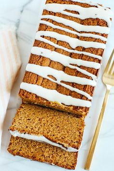 The BEST Almond Flour Pumpkin Bread recipe that is a must to make this fall! Super moist, easy to make and drizzled with a delicious cream cheese glaze!