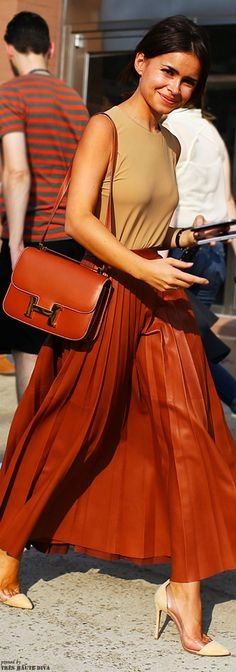 Miroslava Duma at New York FW 's14 in a Celine skirt, Hermes handbag