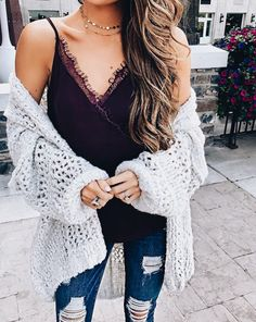 Loose knit sweater paired over a dainty lace trim camisole with distressed dark wash jeans makes for a super cute casual date outfit! #sweater #springfashion #womenswear