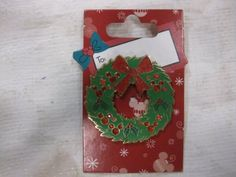 """Disney Pin Collection Christmas Wreath 2008 by Disney. $14.95. Christmas Wreath Pin. On A Card With """"To"""" So You Can Write The Recievers Name If You Want. Has Mickey Emblem In Red Rhinestones. Disney Pin Collection Christmas Wreath 2008"""