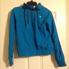 Champions Rain Jacket This rain jacket is really cute and has barely been worn. It looks practically new Champion Jackets & Coats Utility Jackets