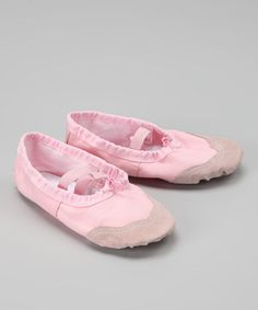 These cozy kicks feature a cool canvas construction and leather lining, while the soft interior feels sweet on tiny ballerina feet.