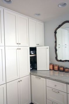 """blind base cabinet goes under """"tall cabinet"""". (1 ceiling wall mount, and 1 hidden door for microwave/ toaster oven)"""