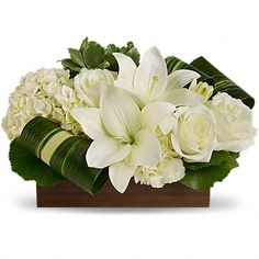 Sweet Desire - Send Fresh Flowers Internationally   Lovely and serene as a Zen garden, this exquisite bouquet of white roses, lilies and hydrangea in a natural bamboo vase is a gift of love that will be long remembered. Send it to someone very special.