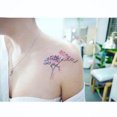 : Freesia 🌸✨ . . #tattooistbanul #tattoo #tattooing #freesia #freesiatattoo #flowertattoo #flower #타투이스트바늘 #타투 #프리지아 #컬러타투 #꽃타투