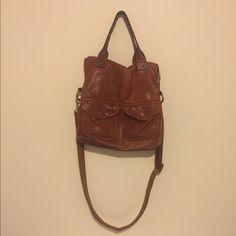 Leather purse by Fossil Versatile leather bag by Fossil. Can use the arm strap or the handles. Me and this bag had a great run together and she still has a lot of life left. I'd say it's in good condition tho there is wear on the handle straps (see last pic) It measures roughly 13x13 Fossil Bags Shoulder Bags