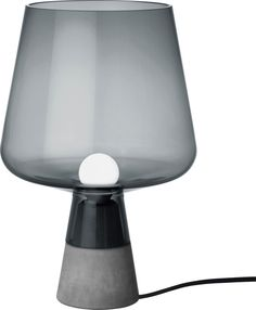 Iittala - Leimu Lamp 300x200 mm grey - Iittala.com. Leimu lighting piece combines a strong concrete base and an impressive glass lamp portion.