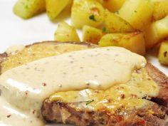 sauté de porc, oignon, carotte, beurre, huile d'olive, vin blanc, eau, crème fraîche épaisse, moutarde, farine