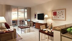 Sonesta Bayfront Hotel: One-Bedroom Biscayne Suites are 800 to 900 square feet with a kitchen, dining area and balcony.