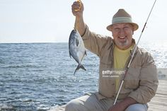 Portrait Of Man With A Fresh Caught Fish Stock Photo   Getty Images