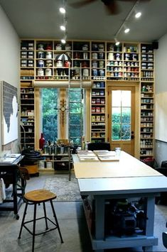 Studio - Mark F. Elliott #workspace.  What great storage.  How about doing this on a long wall with a library ladder too?