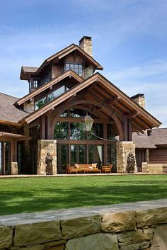 "Like the arched timber framing under the overhang and the ""turret"" and triple roofline!"