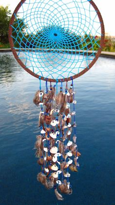 Turquoise Sea Shell Dream Catcher by FollowYourDreams18 on Etsy, $25.00
