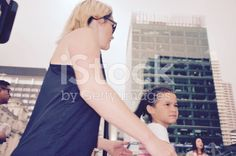 Mother and Daughter walking in Urban Scene royalty-free stock photo