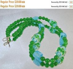 This #vintage blue green Murano art glass necklace is simply lovely!  It features round glass beads in brilliant green alternating with aqua blue art glass beads accented wi... #ecochic #etsy #jewelry #jewellery