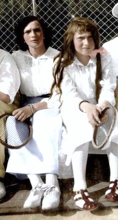 Grand Duchesses Tatiana and Anastasia relax at one of their family's tennis courts.