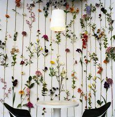 silk & plastic flowers with stems taped to create 3D wall