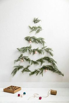 Forget traditional Christmas tree methods, this year we're making ours from scratch. This new take on the tree definitely ticks our environmentally friendly boxes.