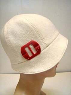 >I was watching 'Changling' on HBO last night. Yes, it's a somewhat depressing movie. But I have to say that Angelina Jolie looks stunning in her cloche hats and bright red lip…