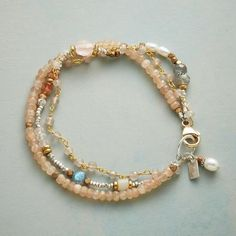 """MELLOW MEDLEY BRACELET Item No. 73811$138.00 Hushed tones and quiet beauty abound in our triple-strand bracelet mingling peach moonstone, pearls, brass, sunstone, labradorite and rose quartz. 14kt gold-filled lobster clasp. Sterling silver. USA. Exclusive. 7-3/4""""L."""