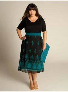 I think this plus size dress could be cute with the right accessories. The clutch is too matchy...