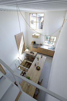 Small kitchen amazing use of space The dining table is supported by the stair railing