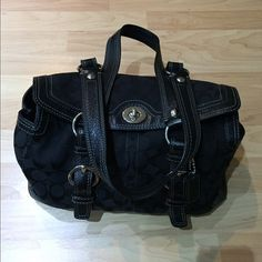 Coach Signature C Bag Excellent condition, not used at the moment and need to clear closet space.  Fabric signature C coach shoulder bag, black exterior, gray interior, and silver buckles.  Twist clasp to close, zipper interior pocket and 2 accessory pockets. Coach Bags Shoulder Bags
