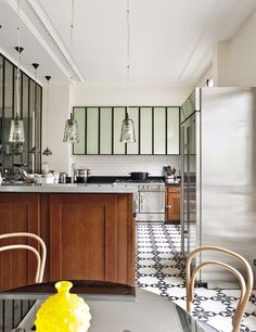 NOTE: upper cabinets-wonder what they're made of? Paris Apartment by Sandra Benhamou