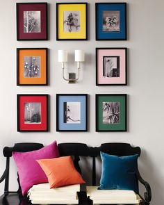Black-and-white photographs with rainbow photo mats.