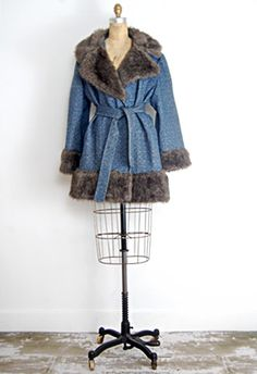 Blue Ridge Cabin Coat  Vintage 1970s blue wool coat with matching tie belt. Features large faux fur collar and bell sleeves with faux fur trim