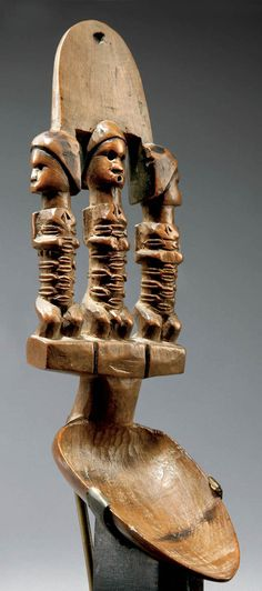 Africa | Spoon from the Bembe people of DR Congo | Wood; with 3 characters with scarification (a man between two women) | ca. late 19th century