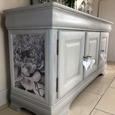 Painted in Annie Sloan Paris Grey and finished with clear wax. The flower detail has been decoupaged on.