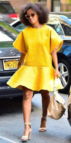 Solange Knowles in a cheery yellow look.