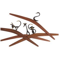 Four Walter Bosse Bronze and Wood Coat Hanger by Baller, 1950s | From a unique collection of antique and modern coat stands at https://www.1stdibs.com/furniture/more-furniture-collectibles/coat-stands/