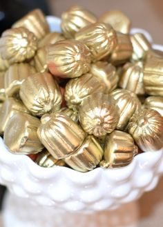 Halloween decoration DIY: Chic up your candy pumpkins with some gold.