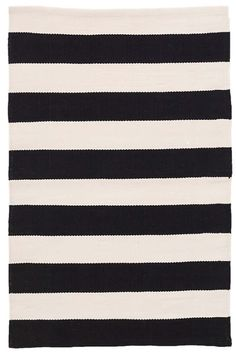 Dash and Albert Catamaran Stripe Black/Ivory Indoor/Outdoor Rug. The broad black and ivory stripes on this durable and lightweight indoor/outdoor rug can fit right in to both modern and nautical décor schemes alike. Terrasse Design, Dhurrie Rugs, Dash And Albert, Rug Company, Striped Rug, Indoor Outdoor Area Rugs, Indoor Outdoor Carpet, Outdoor Spaces, Outdoor Decor