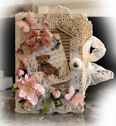 Altered Book Box~Design Team work for Tresors De Luxe using Tresors Lace, Crochet Heart Applique and Flowers.   You can add that Tresors touch to your projects by visiting Lucy here: https://www.etsy.com/shop/TresorsdeLuxe  The Shabby Chic Teddy Bear Tag is from my Reneabouquets Etsy Shop and can be found here: https://www.etsy.com/shop/Reneabouquets