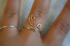 Gold Colored Swirl Ring. $10.00, via Etsy.