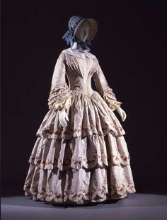 "Women's walking dress in silk taffeta and damasked ""fontana"" frills. Embroideries in floral motifs in tobacco colour, with garlands and silk trimmings; Italian manifactury, 1845 ca."