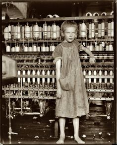 """February 1910. Addie Card, 12 years old, anemic little spinner in North Pownal Cotton Mill, Vermont. Girls in mill say she is ten years. She admitted to me she was twelve; that she started during school vacation and would """"stay.""""  by Lewis Wickes Hine. """"It always amazes me to see kids working without shoes in factories where you would not dare to enter without workboots nowadays... how times change. I can't imagine not having shoes in a place like Vermont where it's warm only 3-4 months a…"""